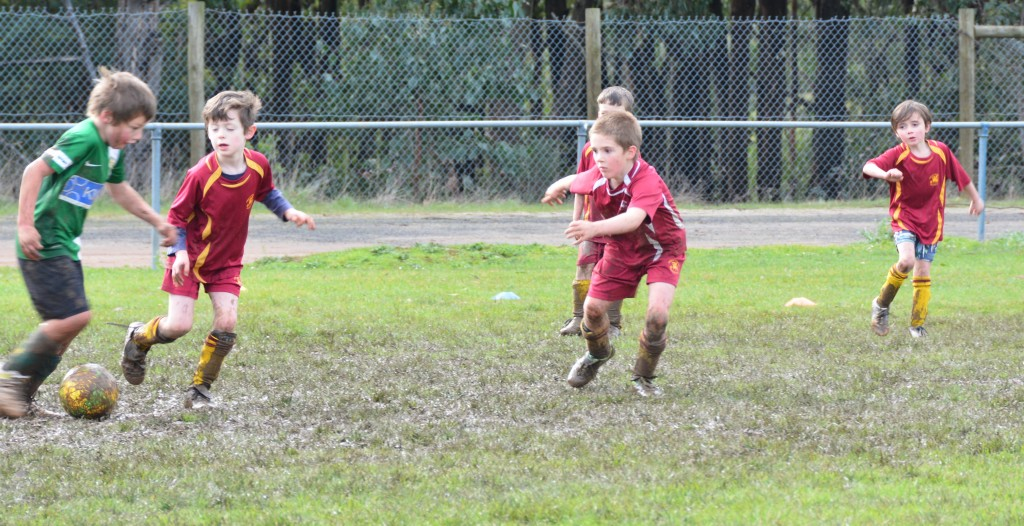 under 7s playing in the mud